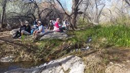 Hikers_resting_beside_MCW_stream
