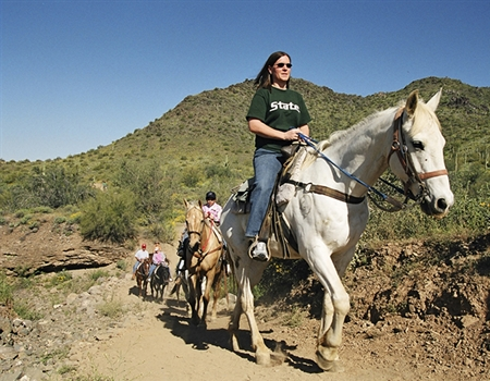 Cave_Creek_Regional_Park_-_Visitors_enjoying_a_leisurely_horseback_ride